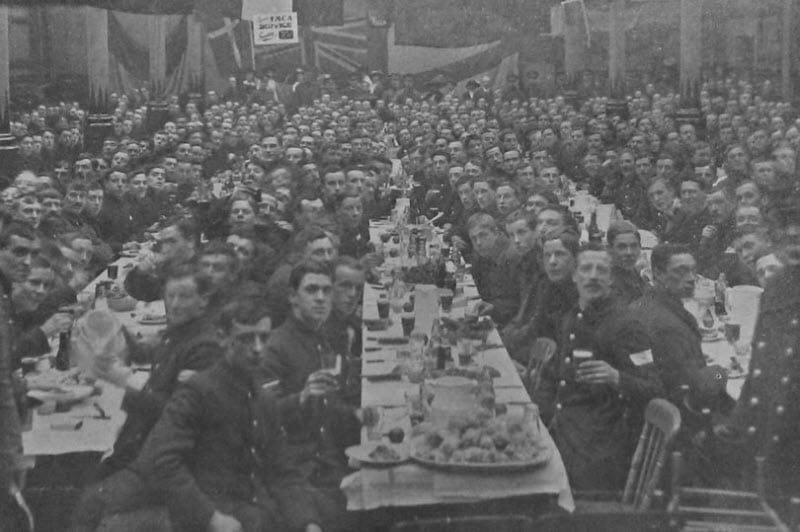 The men of the 7th Battalion Royal Berkshire Regiment sit down to their dinner at the Corn Exchange